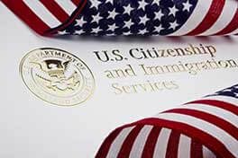 US Citizenship & Immigration Services Seal surrounded by American flags