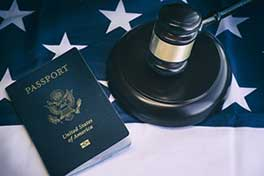 Image of a US passport and gavel. Common in employment immigration