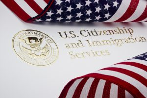 U.S. Citizenship & Immigration Logo & U.S. flag