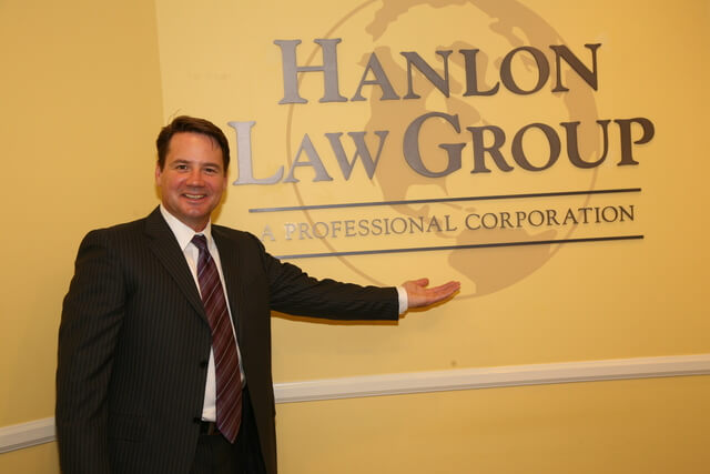 Attorney Dan Hanlon in front of office logo