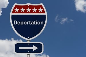 deportation road sign with background clouds