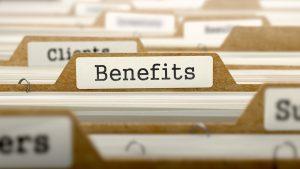 a file folder labeled Benefits, among other file folders