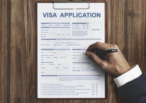 filling out an immigration visa application
