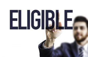 "man pointing to the word ""ELIGIBLE"""