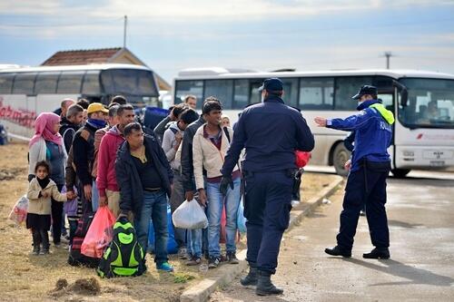 Syrian refugees waiting for transportation