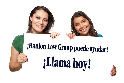 two mexican women holding a call now sign
