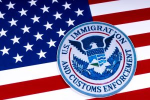 U.S. Customs & Immigration Enforcement patch over the U.S. flag