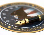 U.S. Immigration Enforcement seal and pen