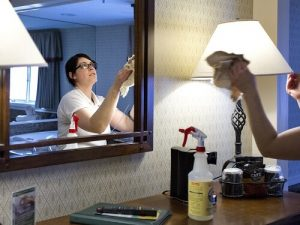 H-2B Visa worker lady cleaning hotel rooms