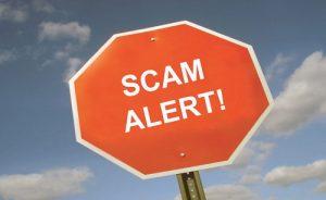 scam alert stop sign
